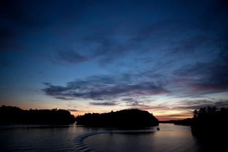 Muskoka Ontario, Canada -   Sunset on Lake Rosseau in the Muskoka region of Ontario Canada.