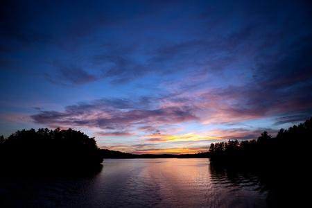 Muskoka Ontario, Canada -   Sunset on Lake Rosseau in the Muskoka region of Ontario Canada.   Stock Photo