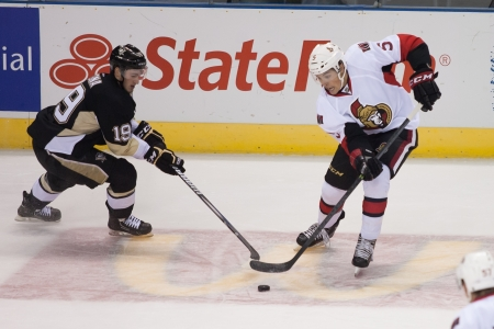 Ottawa Senators defenseman Cody Ceci (5) avoids a check from Jayson Megna (19) of the Pittsburg Penguins during a game at the 2013 National Hockey League Rookie Tournament being played at the Budweiser Gardens in London Ontario, Canada on September 5, 201