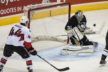 Pittsburg goalie Eric Hartzell makes a save during a game at the 2013 National Hockey League Rookie Tournament being played at the Budweiser Gardens in London Ontario, Canada on September 5, 2013. The Ottawa Senators defeated the Pittsburg Penguins by a s