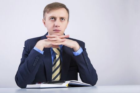 seeks: Caucasian business man thinking about business. Stock Photo