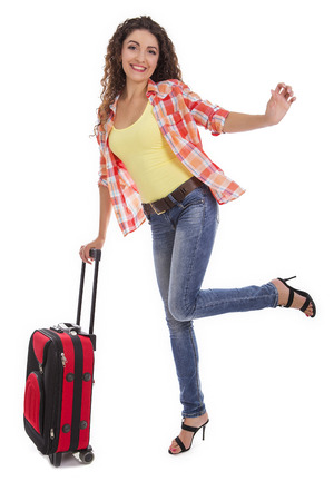 take time off: Travel and adventure concept. Beautiful Caucasian woman with a suitcase.
