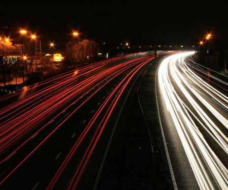night time traffic motion-blur service station photo