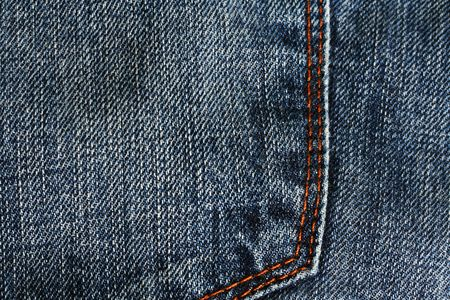 back pocket: back pocket of denim jeans with orange seam