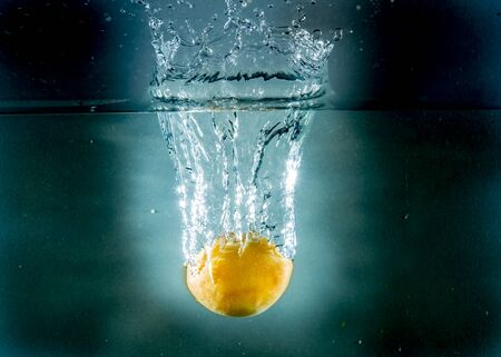 yelow: Different fruit in different colors, yelow, red, orange, thrown into water to create splash effect