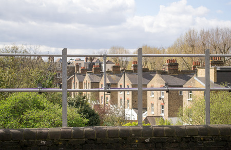 European urban city view behind the fence in West London, United Kingdom Stock Photo