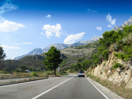 Mountain serpentine road view in the heart of Europe Stock Photo - 58597053