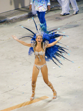 Rio de Janeiro, Brazil - February 23: amazing extravaganza during the annual Carnival in Rio de Janeiro on February 23, 2009 - semi naked female dancer