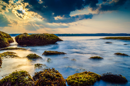 A tranquil time exposure of a rising tide on the coats of Miane. Stock Photo