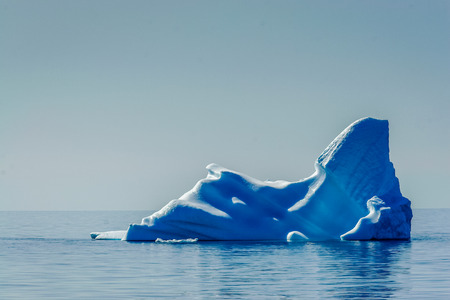 icefjord: A Lone, blue iceberg melts in the Arctic sun