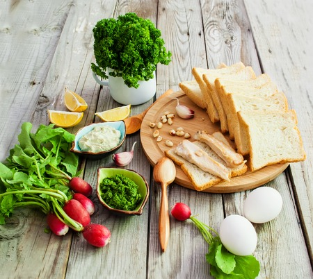 aliments: Top view foodstuffs for sandwiches on wooden background.