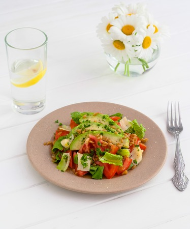 Spelt salad with vegetables and olive oil.