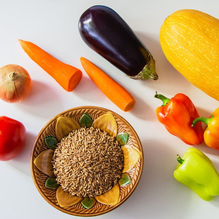 foodstuffs: Colored foodstuffs  - vegetables and speltal on a table.