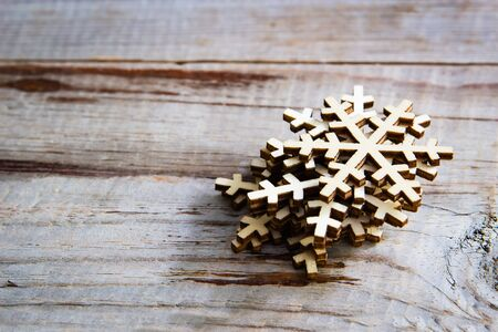 Snowflakes on wooden background. Winter holidays concept. Stock Photo