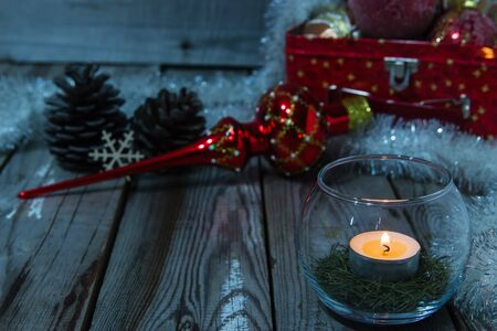 cosily: Beautiful christmas composition with candle on wooden background