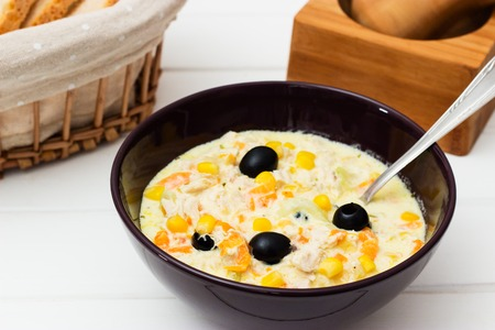 Lunch or dinner creamy chicken soup on a white background.