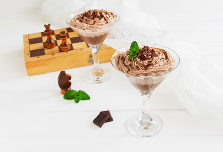 Chocolate mousse with avocado in martini glass.