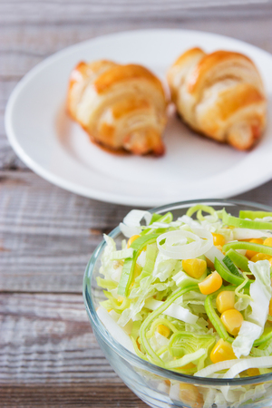 Vegetarian salad and cheese croissant.