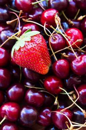 Fresh organic Cherry sweet and Strawberry for harmony slimness vetical. Stock Photo
