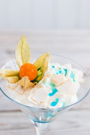 trifle: Pavlova in martini glass with syrup blue curacao.