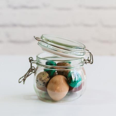 quail: Quail easter painted eggs in glass jar.