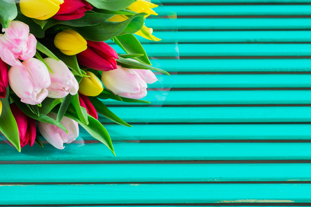 Blurred bouquet tulips jade shamrock wooden background