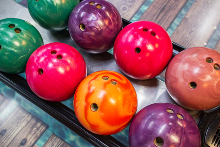 Variety coloful bowling balls activity sport background.