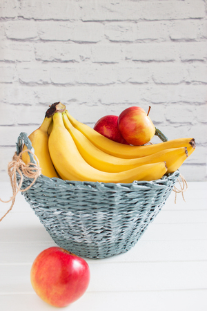 Fruit colorful harvest willow gray handmade basket. Stock Photo
