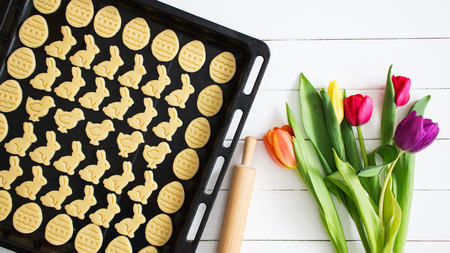 Easter shortcrust traditional cookies tulips bouquet black tray.