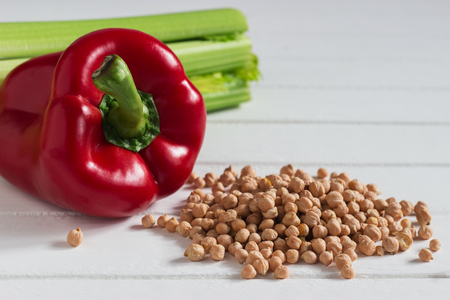 Red pepper celery chickpeas colored vegetarian products. Archivio Fotografico