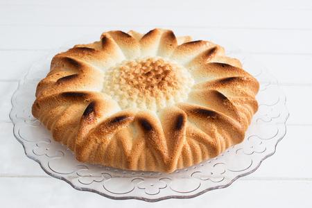 Angel food cake sunflower shape white table.