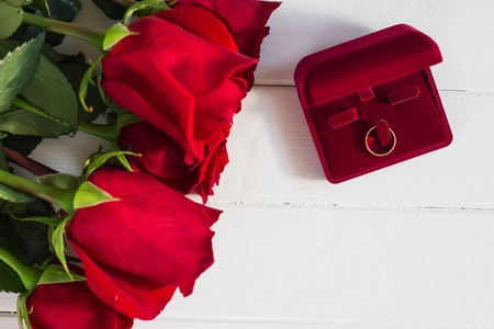 Red roses romantic proposal background white wooden.