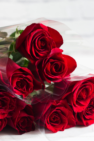 Red roses bouquet white background copy space.