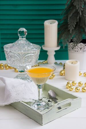 Frozen talian creamy tangerine dessert crystal dishes close up.