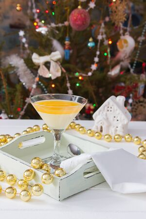 Martini glass italian tangerine dessert Christmas garland background.