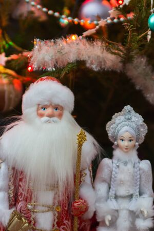 Winter fairytale character christmas tree selective focus.