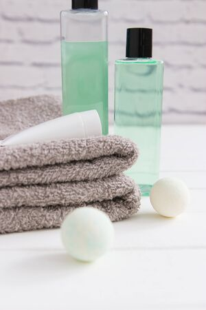 Relax concept beauty products two gray towels vertical front view.