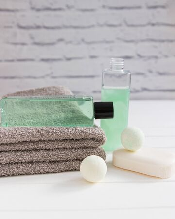 Bath stuff beauty concept two gray towels vertical front view. Reklamní fotografie