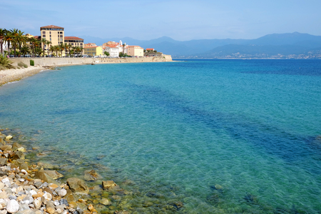 Ajaccio cityscape with old typical houses, beach and the sea with crystal water on the Corsica island, France.