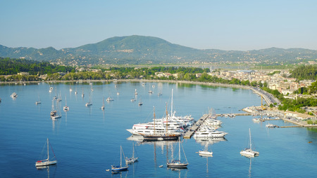 Aerial view on the town Kerkira and white boats in the Garitsa Bay on the Island Corfu, Greece.
