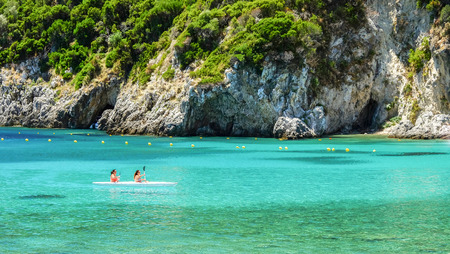 PALEOKASTRITSA, CORFU, GREECE - JULY 3, 2017: Aerial view on the bay and beach Paleokastritsa with crystal sea water on the Island Corfu, Greece.