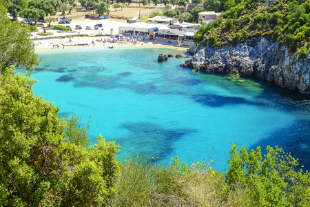 paleokastritsa: Aerial view on the bay and beach Paleokastritsa with crystal sea water on the Island Corfu, Greece.