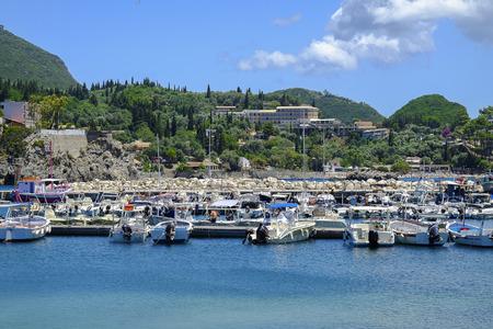 paleokastritsa: View on the pier with boats in Paleokastritsa on the island Corfu, Greece.