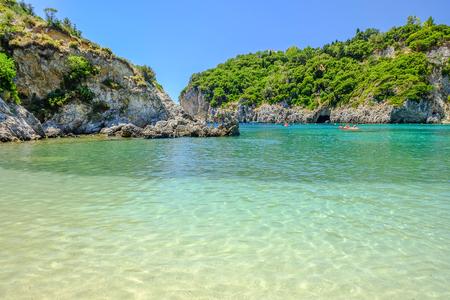 View on the bay and beach Paleokastritsa with crystal sea water on the Island Corfu, Greece. Stock Photo