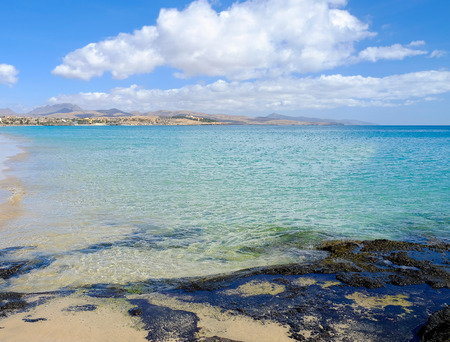 View on the beach in Costa Calma and blue ocean on the Canary Island Fuerteventura, Spain.