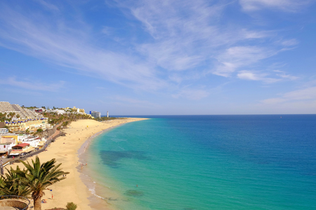 View from above on beach with golden sand and ocean. Location Morro Jable, Fuerteventura, Canary Islands, Spain.