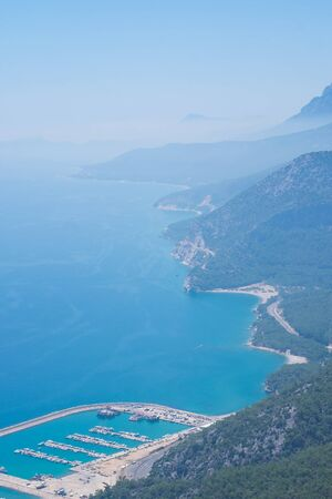 Aerial view on Taurus mountians covered with haze and the blue sea in Antalya, Turkey.