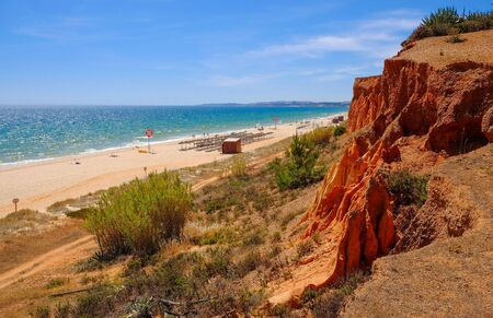FALESIA, ALGARVE, PORTUGAL - MAI 25, 2019: View on the beach Praia da Rocha Baixinha Nascente with beautiful red sandstone cliffs and golden sand. Editorial