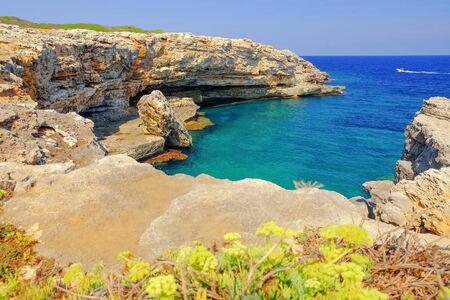 Landscape with a lagoon with crystal water and cliffs on Menorca, Balearic Islands, Spain. Reklamní fotografie
