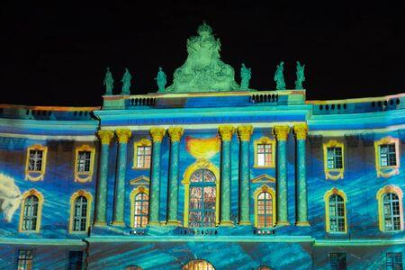 HUMBOLDT UNIVERSITY, BERLIN, GERMANY - OCTOBER 20, 2019: Installation during the Festival of Lights in Berlin. View on the Humboldt University. 에디토리얼